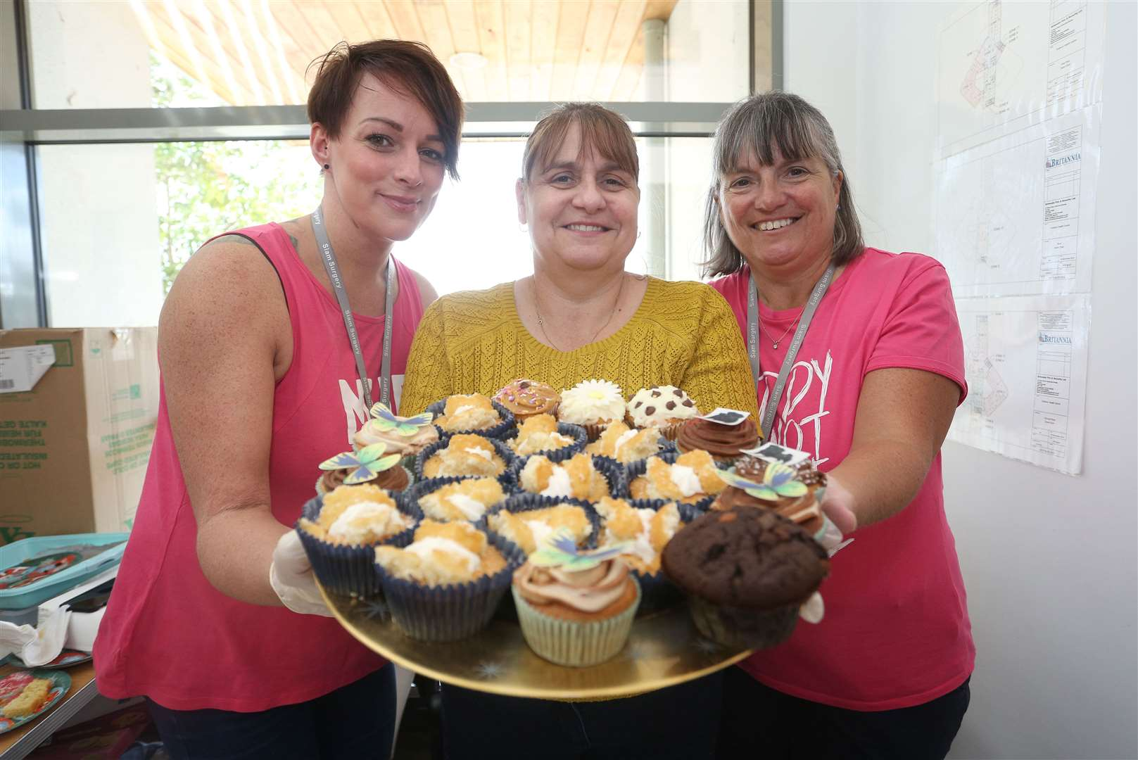 McMillan Coffee morning and walk in clinic event at Sudbury Community Health Centre - (L-R)Amy Bates, Sue Lowe and Di Cunningham sell some cakes at the event..Pic - Richard Marsham. (17919190)