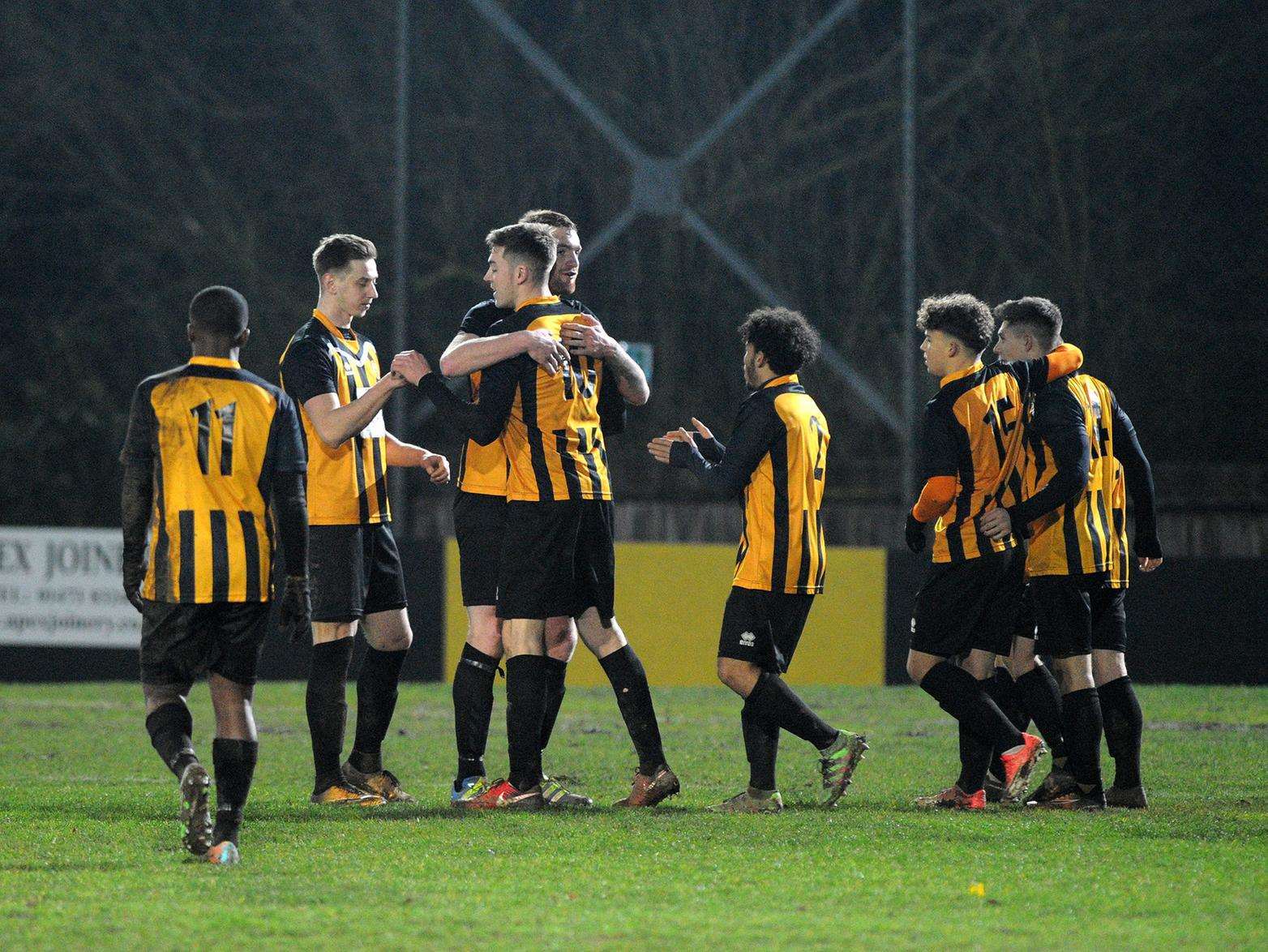 BIG WIN: Stow celebrate their victory over Fakenham. Picture: Mecha Morton