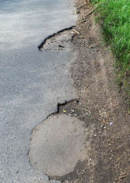 Rougham residents are angry about the potholes in the road that are not being fixed.'''Picture: Mecha Morton