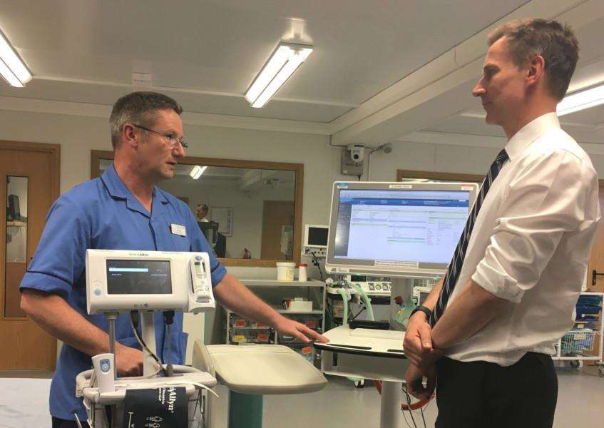 Nurse and nursing informatics lead Ian Coe, left, demonstrating a vital signs monitor to Jeremy Hunt on his visit to West Suffolk Hospital