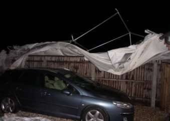 A marquee in West Row, which was blown into the graveyard in Chapel Road during high winds overnight. ANL-150331-115902001