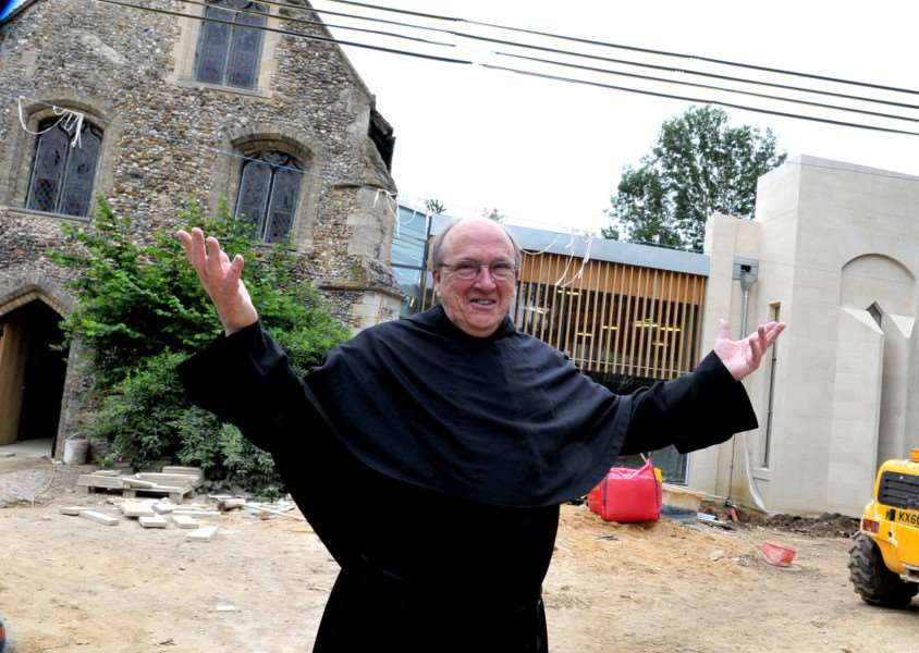 Father Bernard Rolls outside the Clare Priory extension as it was being done.