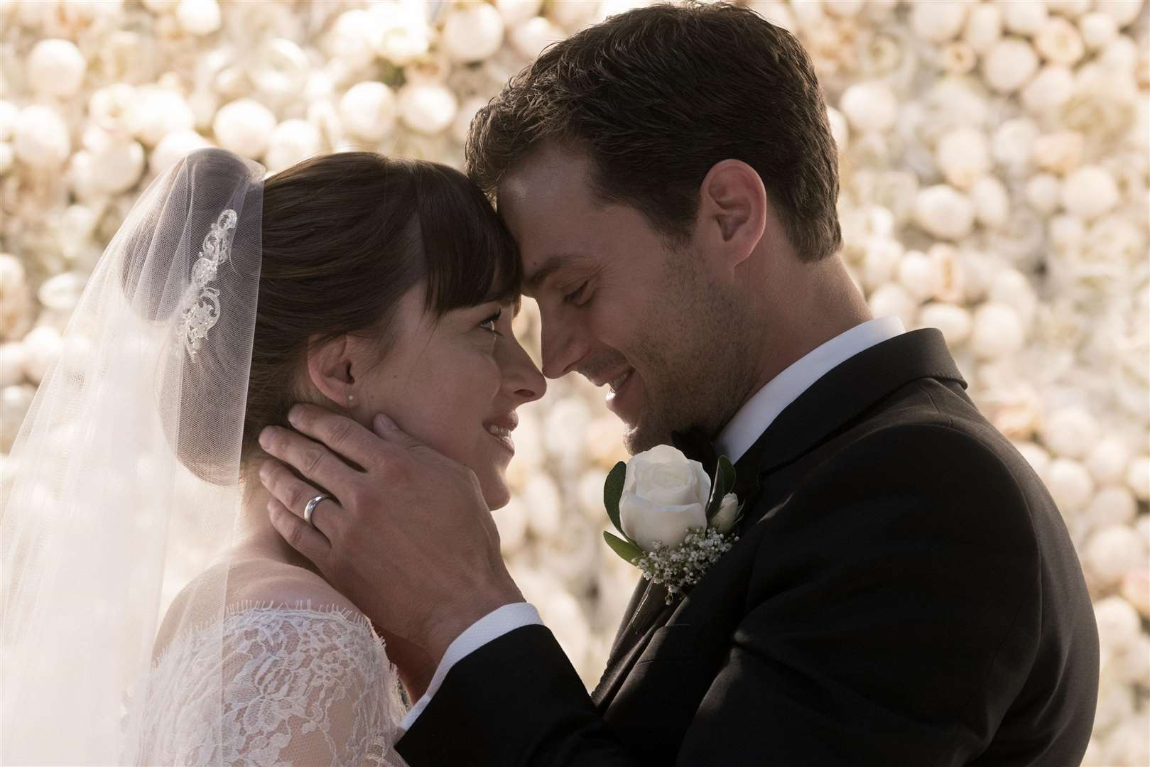 Undated film still handout from Fifty Shades Freed. Pictured: Dakota Johnson as Anastasia Steele and Jamie Dornan as Christian Grey. See PA Feature SHOWBIZ Film Digest. Picture credit should read: PA Photo/Universal Pictures/Doane Gregory. WARNING: This picture must only be used to accompany PA Feature SHOWBIZ Film Digest.. (2560619)