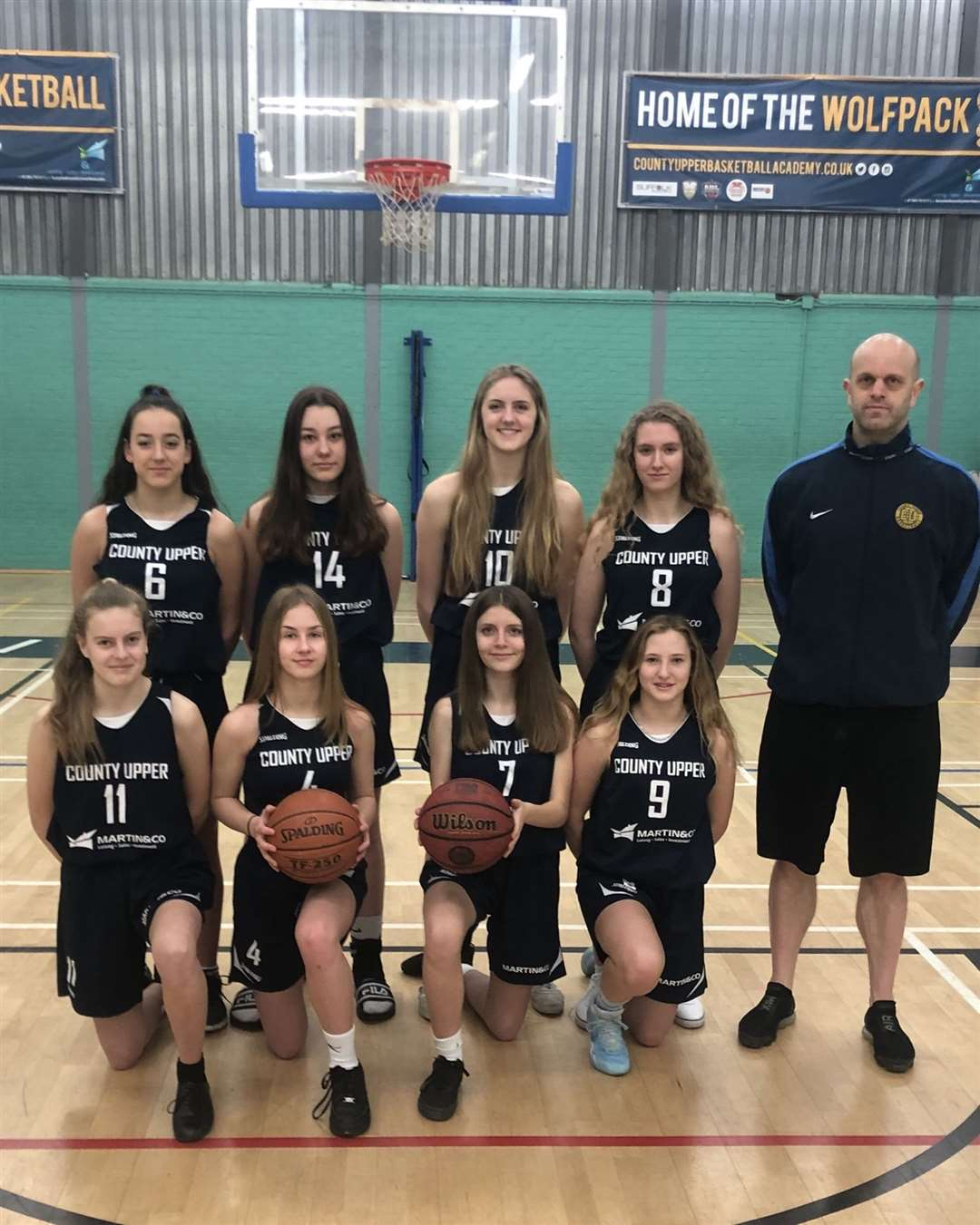 County Upper's U19 Girls Basketball Academy team have been named co-national champions after their Basketball England U19 Schools Championship final was called off due to the coronavirus pandemic - coach Darren Johnson pictured with the team (37145017)