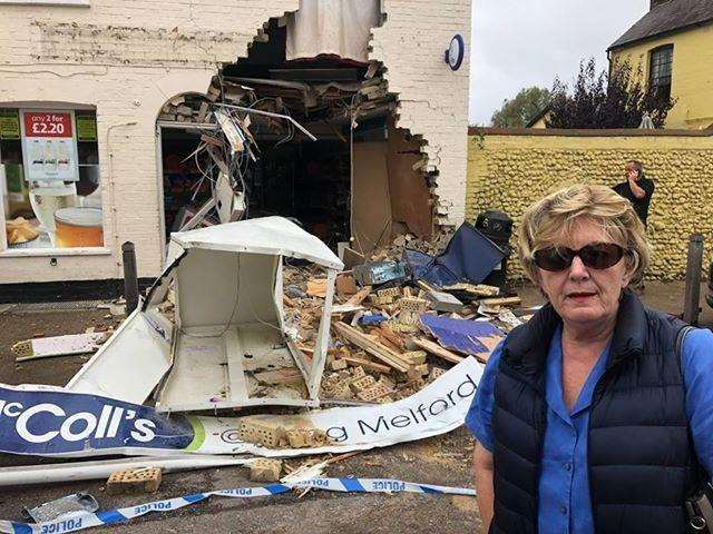 Long Melford Parish Council chairman Liz Malvisi at the scene of the ram raid at McColl's in Long Melford. Picture supplied by Cllr Paul Moreton. (4774028)