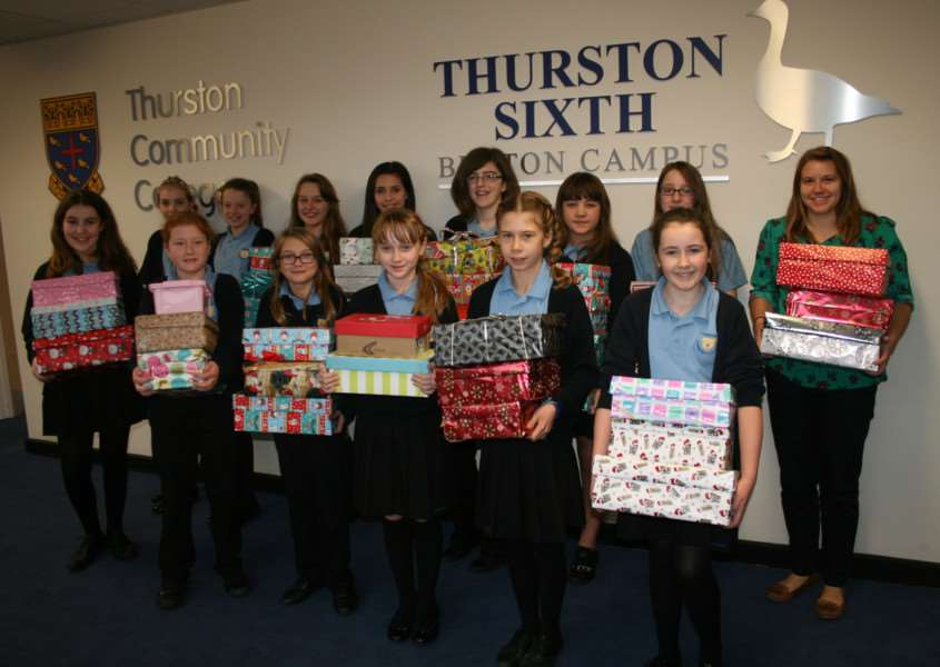 Thurston Community College students with some of the shoeboxes they have filled to help those in need in Serbia and Romania