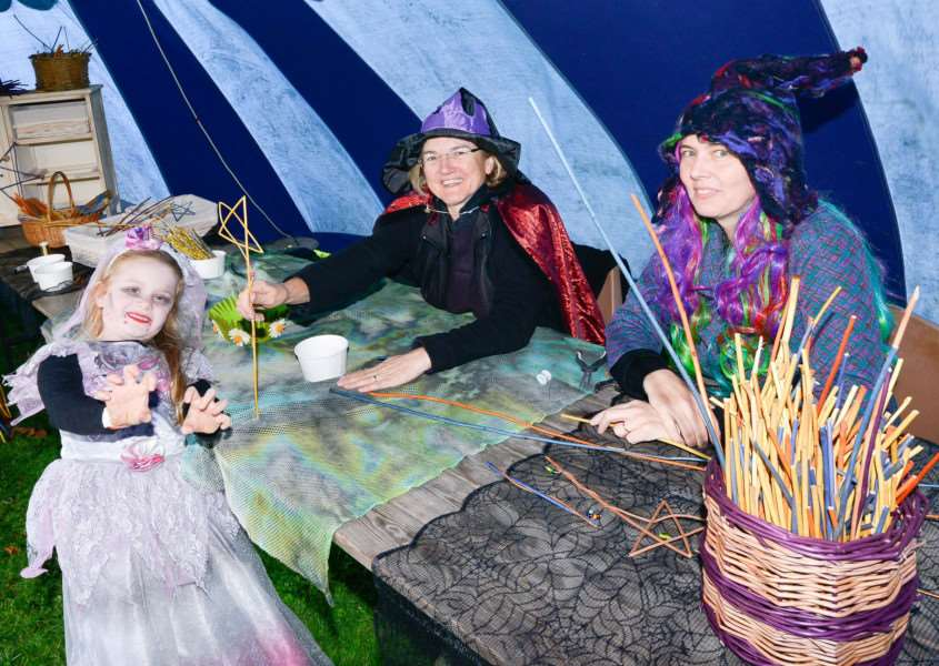 School of Sorcery and Magic at Kentwell Hall in Long Melord. Lauren McKenna with wand makers Eleanor Jenkins and Katy Salmon.