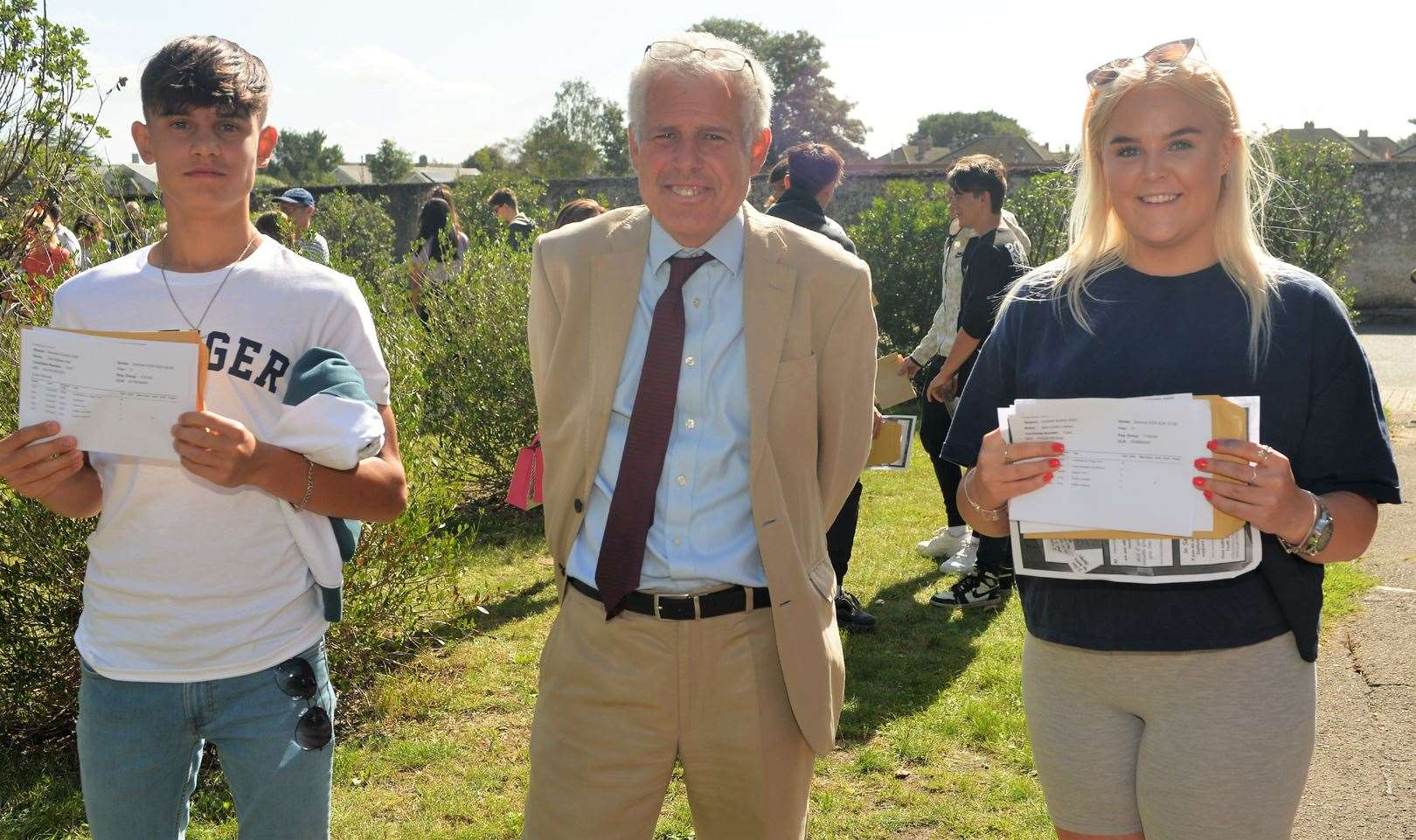 Headteacher Nick Froy with Zak Hall and Mia Loades (40905821)