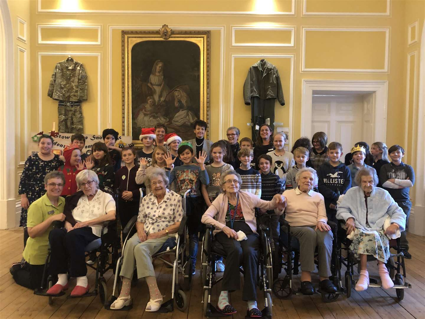 Staff and residents at Stowlangtoft Hall with Bury St Edmunds MP Jo Churchill and Year 6 pupils from Norton Primary School. Picture: Alex Ball.