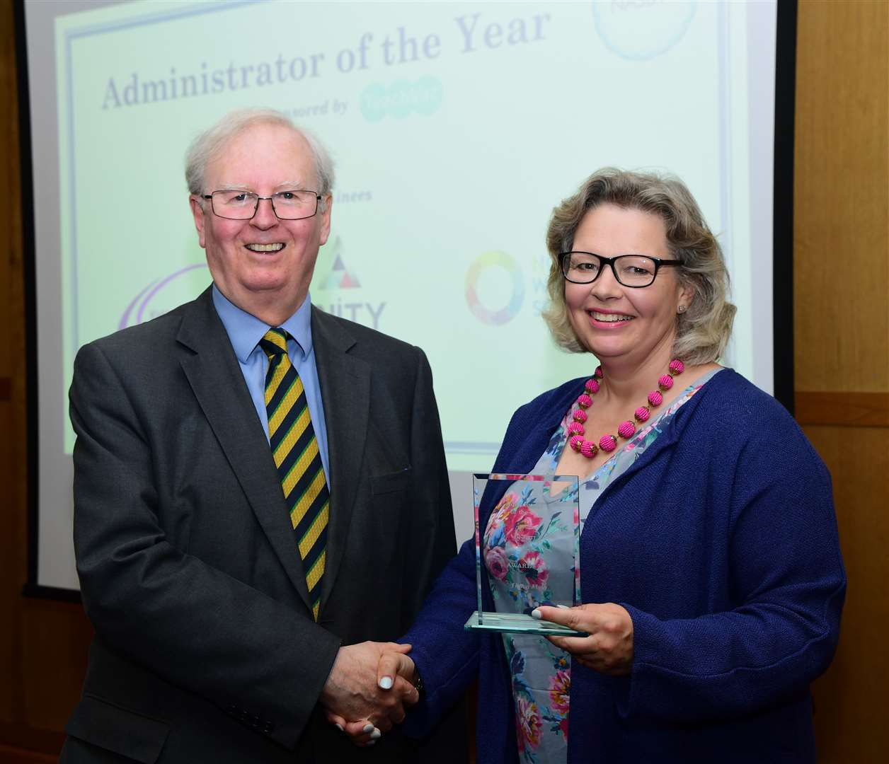 Helen Main receives her award from John Howson, of sponsor TeachVac