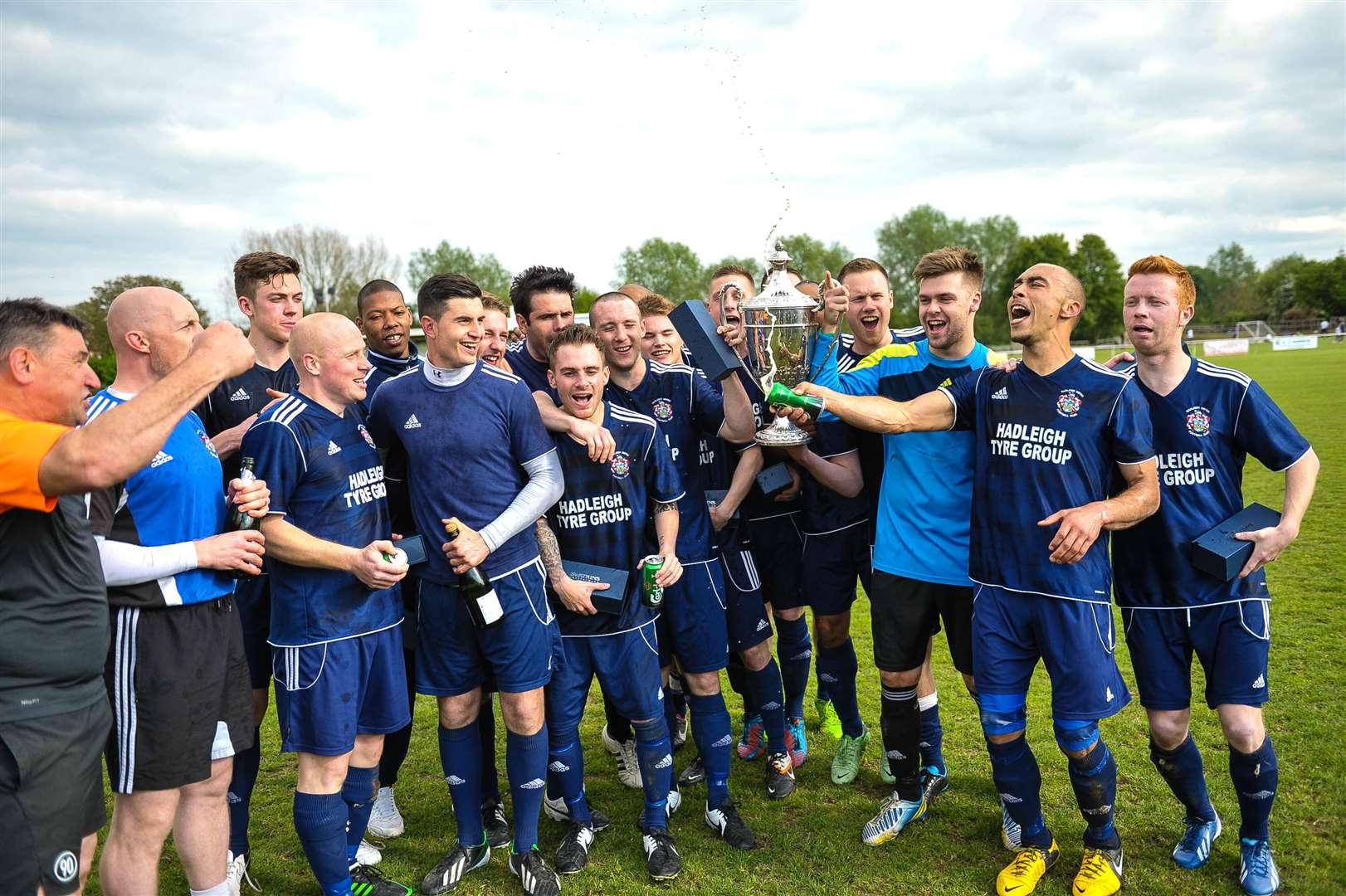 Hadleigh United players and staff celebrate with their medals and the Premier Division trophy following victory against MildenhallPictures: Ben Carmichael