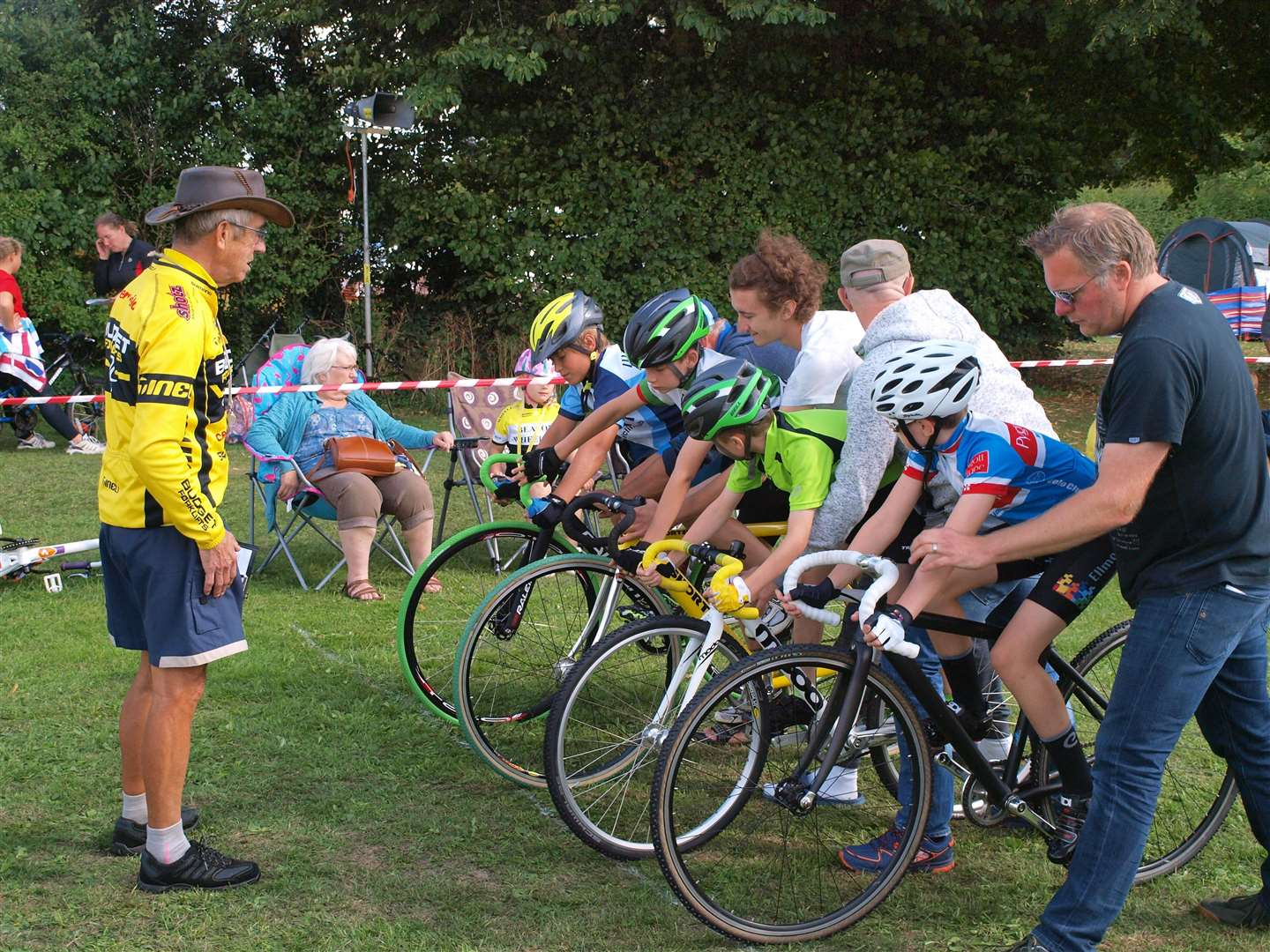 START LINE: Max Pendleton (Organiser of the grass-track) briefs the riders in the Under-12s' Keirin race