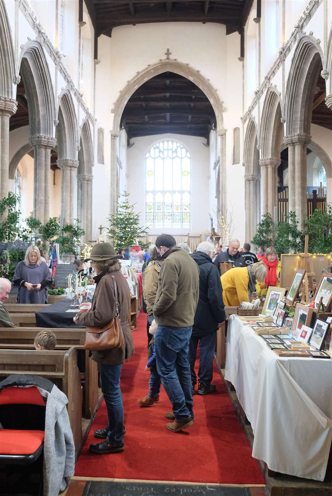 Clare Christmas Fayre - Visitors enjoy the fayre in St Peter and St Pauls Church in Clare..Pic - Richard Marsham. (5724020)