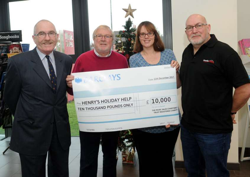 Music Sales has donated �10,000 to Henry's Holiday Help- Neville Wignall (Clerk of Trustees), Ian Morgan (Director at Music Sales and Chair of Trustees), Katie Dalgoutte (Henry's Holiday Help) and Paul Thomas (Trustee) PICTURE: Mecha Morton
