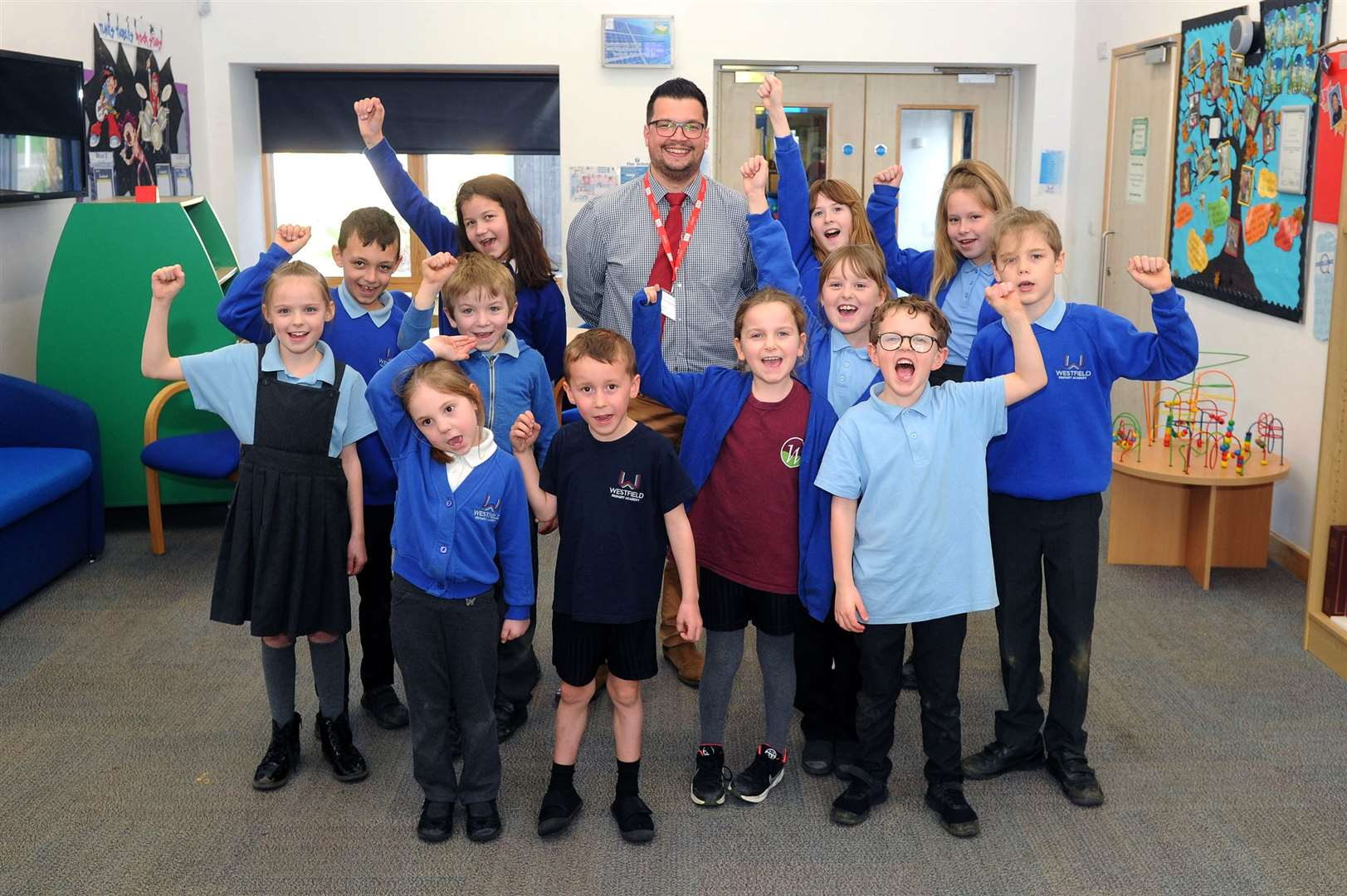 Westfield Primary Academy pupils and head teacher David Maguire were in a jubilant mood after the school's positive Ofsted report. Picture by Mecha Morton.