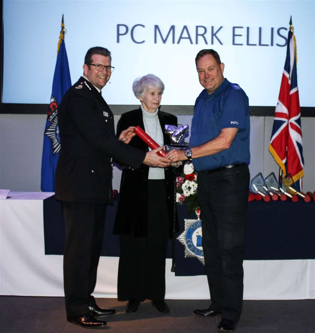 PC Mark Ellis collects his award from Chief Constable Gareth Wilson and Lilias Sheepshanks OBE. Picture: Suffolk Constabulary (7838962)