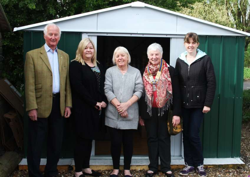 Members of Sunday Suppers, Dottie Mistry, Zoe O'callaghan and Laura Mulvihill with Jenny Benfield and Geoff Pollard from Bury Rotary Club.