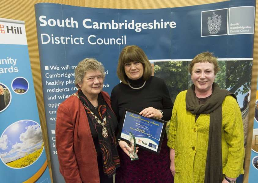 Anne Hall, centre, from Little Abington, winner of the Wellbeing Award at the South Cambridgeshire District Council Communtiy Awards. Wither her is Council chairman Cllr Sue Ellington, left, and ward member for Foxton, Cllr Deborah Roberts.