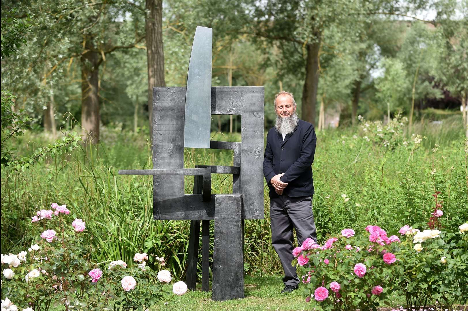 Chappel Galleries has reopened to the public after being closed during lockdown to showcase a coastal scenes watercolours exhibition with a range of sculptures...Pictured: Sculpter Jonathan Clarke with his piece 'Frame of Reference'...PICTURE: Mecha Morton... (37033043)