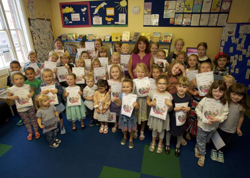 Hadleigh, Suffolk. Children who've taken part in the summer reading challenge at Hadleigh Library with certificates presented by Hadleigh District Councillor Kathryn Grandon. ''Picture: MARK BULLIMORE ANL-160924-224611009