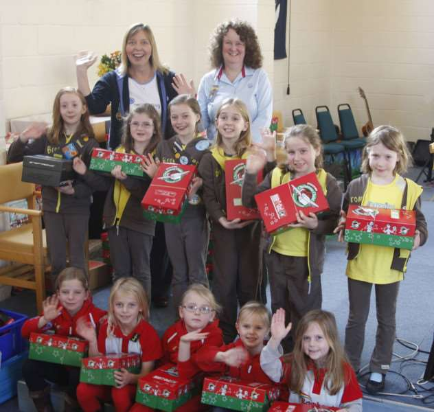 Representatives from 1st Moreton Hall Brownies, and 3rd Bury St Edmunds Rainbows with shoeboxes at Christ Church Moreton Hall on November 22. (Photo courtesy of Robert Archer)