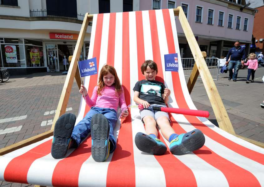 Whitsun Fayre''Pictured: Grace (7) and Theo (6) Smith on the oversized deck chair ANL-160530-194418009