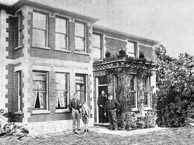 The original Waterwitch House as it looked in 1900 with trainer William Jarvis standing at the front with his youngest son, Jack, who was knighted for his services to horseracing in 1967.