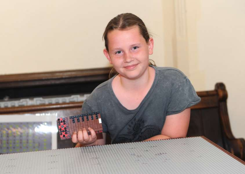 Lego launch at Bury cathedral ''Pictured: Sophie Kemp laying the first lego brick ANL-160530-192930009