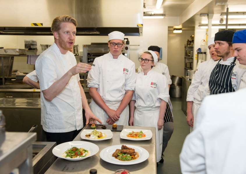 west suffolk college Albert Roux dinner - Toby Stuart (consultant chef for the Roux family) in kitchen with students