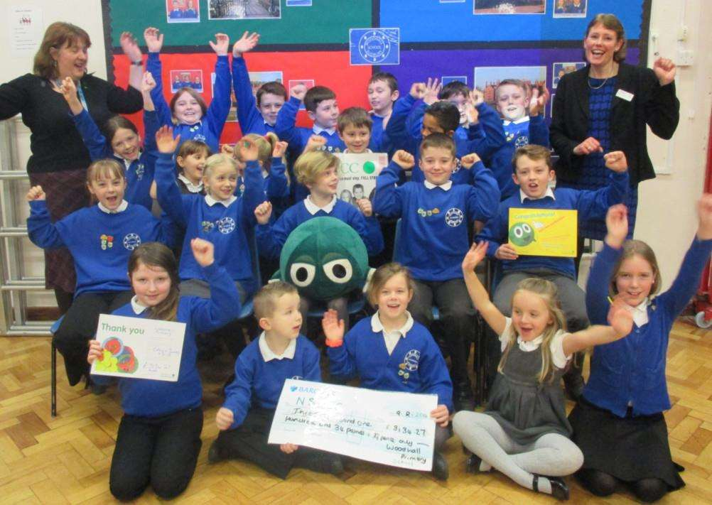 Woodhall primary students with their cheque to the NSPCC. ANL-150217-115405001
