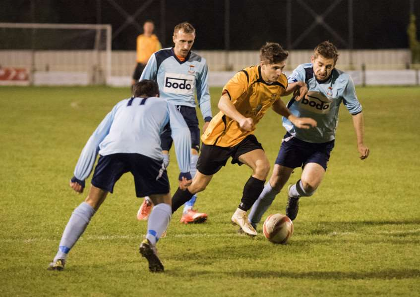 ON THE RUN: George Bugg runs forward with the ball during Stowmarket Town's 3-0 Thurlow Nunn League Challenge Cup defeat against Diss Town