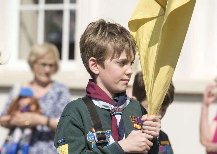 A Scout from Honington carries his unit colours