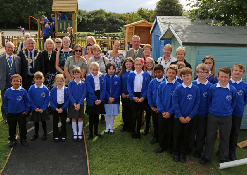 Pupils, staff and guests at the opening of Woodhall primary Schools new outdoor classroom which is memory of late headteacher Lesley Farrow. ANL-150923-124630001