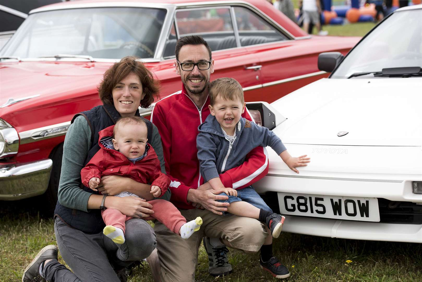 Lindsey and Guy Sanford with Ted and Toby, from Mildenhall, with some of the cars on display at the showPicture by Mark Westley