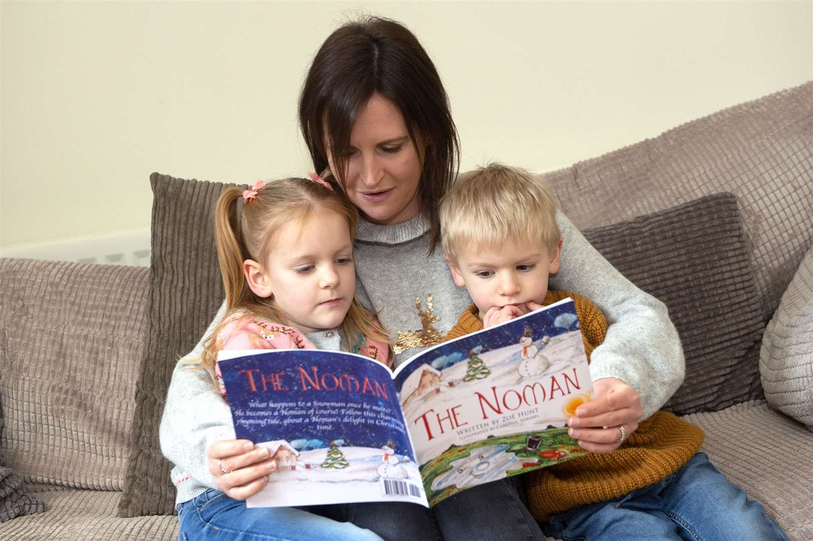 Zoe Hunt reads her debut children's book, The Noman, to her daughter Bella-Rose and son Roman. Picture by Mecha Morton