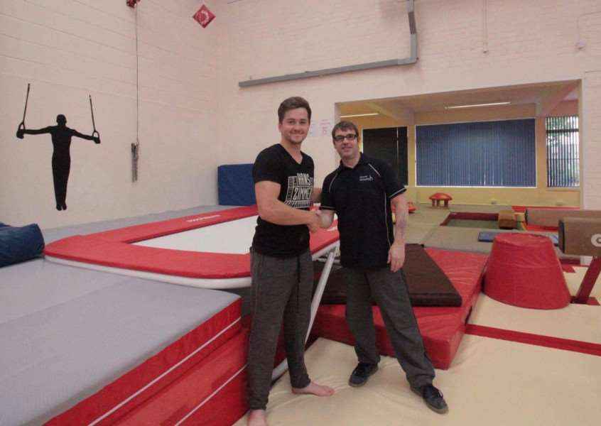 Shane Griffin, left, has made a donation towards the Havethill Gymnastics Club's trampoline fund. He is pictured with the club's head coach, Kevin Woolcott
