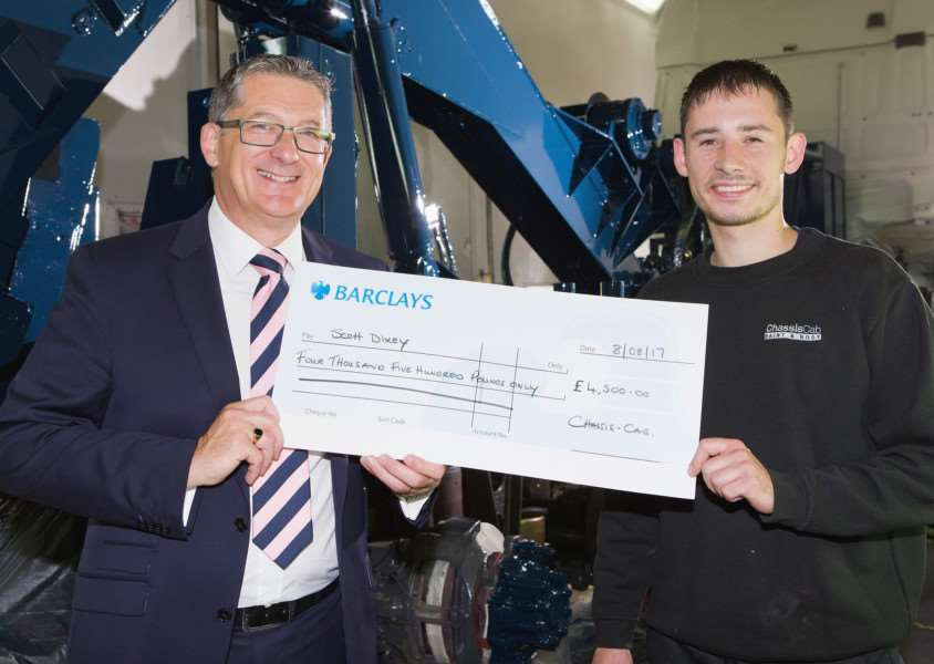 Robert Baxter of Chassis Cab presents a cheque for �4,500 as a loyalty award to technician Scott Dixey