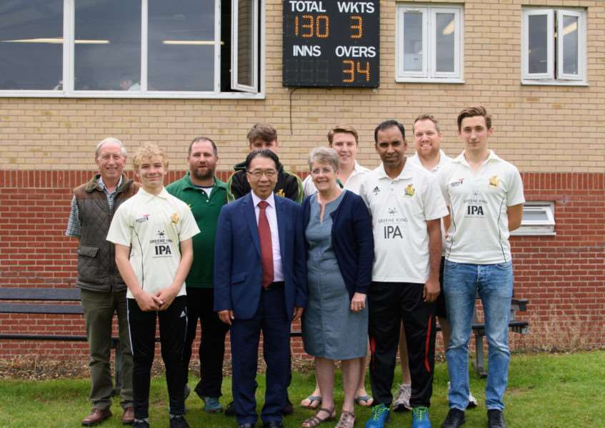 NEW SCOREBOARD: Patrick Chung and Ann Williamson with members of Bury St Edmunds Cricket Club at the official opening of the new scoreboard on the second ground