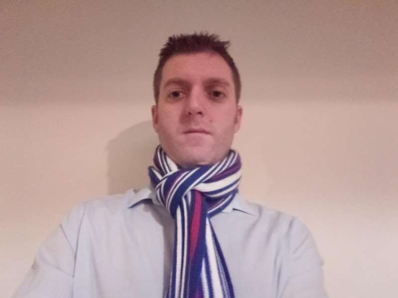 Ipswich Town fan and sports editor Russell Claydon with his 'dirty secret' around his neck