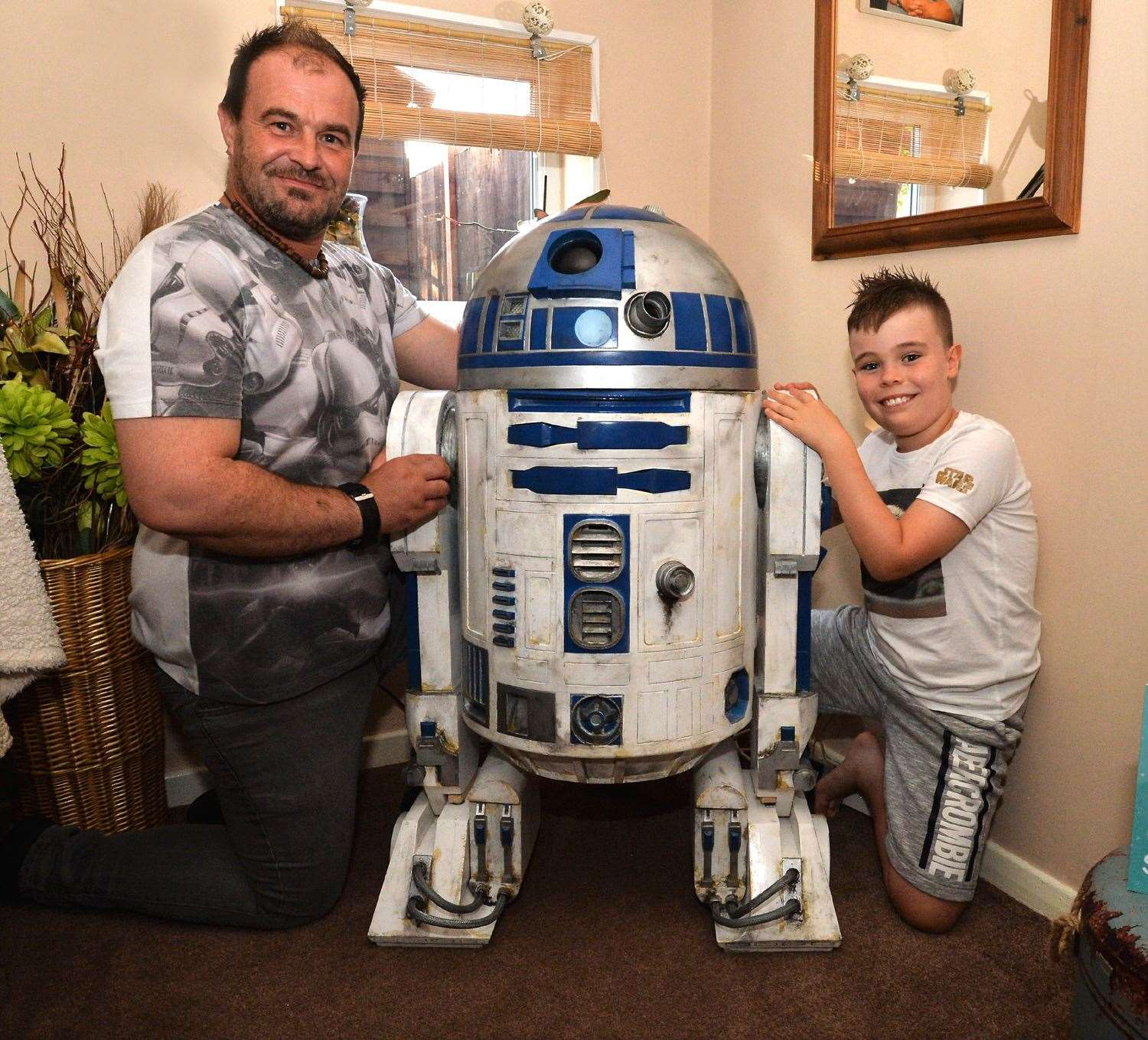 Home from home for R2-D2 with his creator Mark Gibson and his eight-year-old son Rocko.