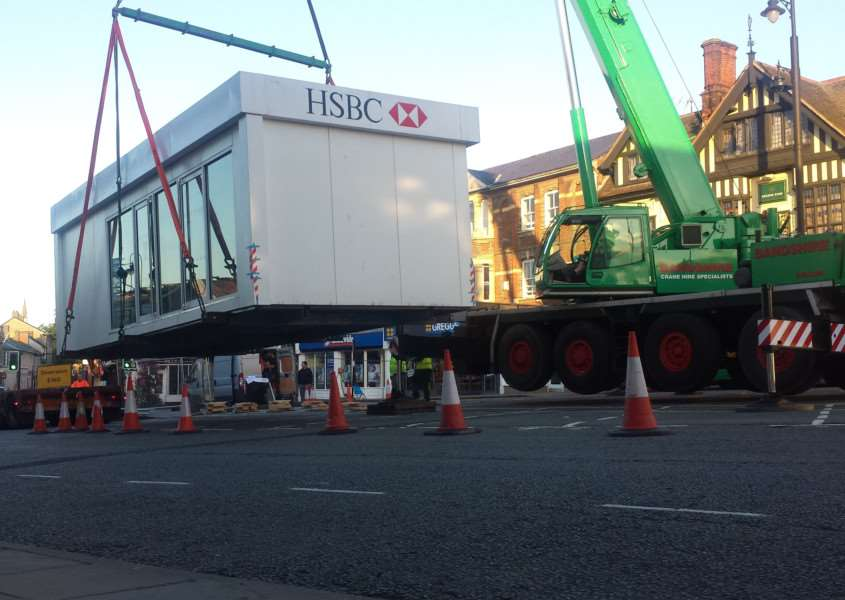 The new HSBC temporary branch was delivered by crane to Sudbury. ANL-150930-111203001