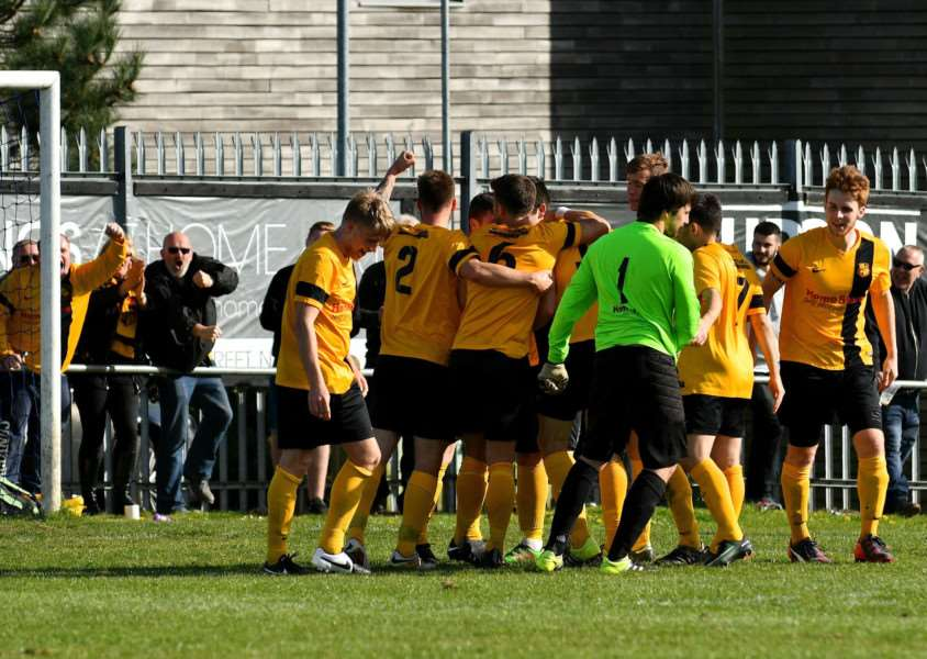 SEWN UP: Mildenhall players celebrate Dan Brown's late goal at Mundford Road, which sealed the league title