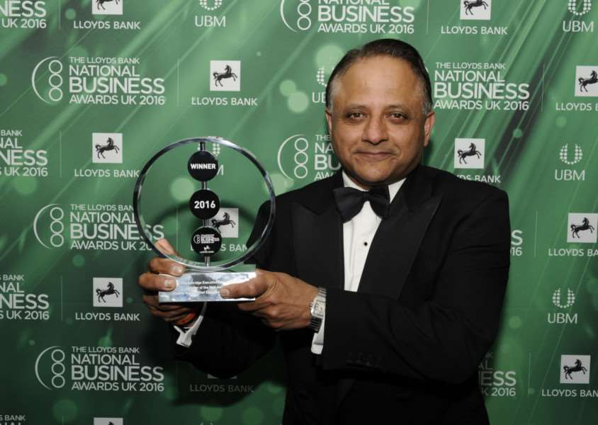 Rooney Anand, chief executive of Greene King, with his award.