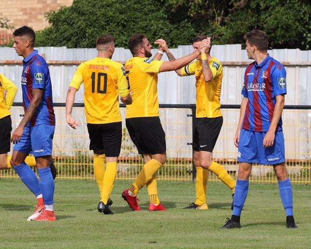 HIGH FIVES: Luke Butcher is congratulated after his goal for Mildenhall. Picture: Gary Donnison