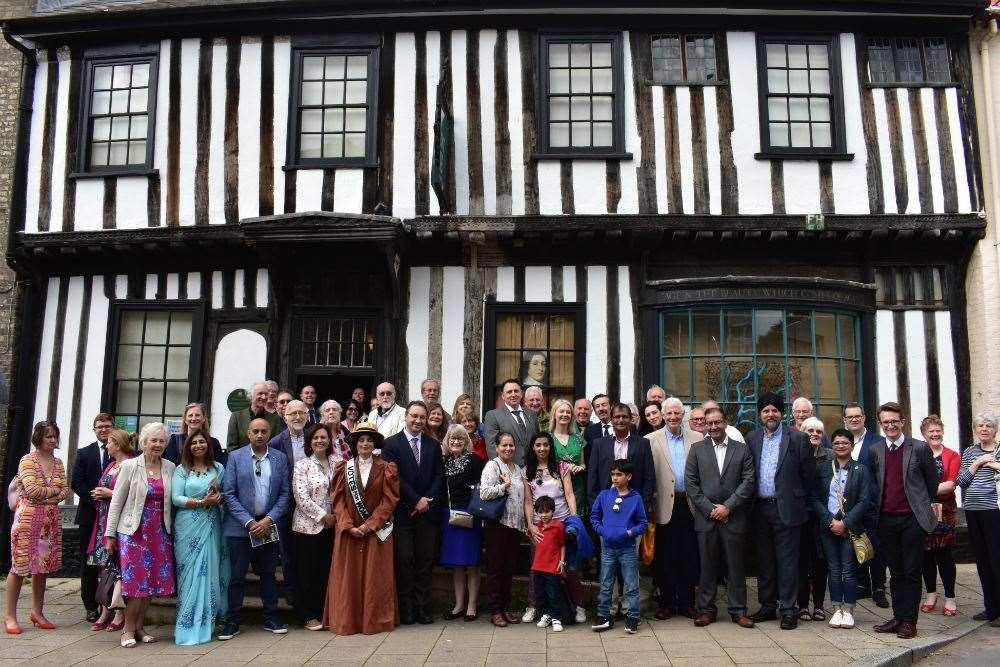 Attendees at the opening of the Norfolk and Punjab Festival, standing outside the Ancient House Museum in Thetford