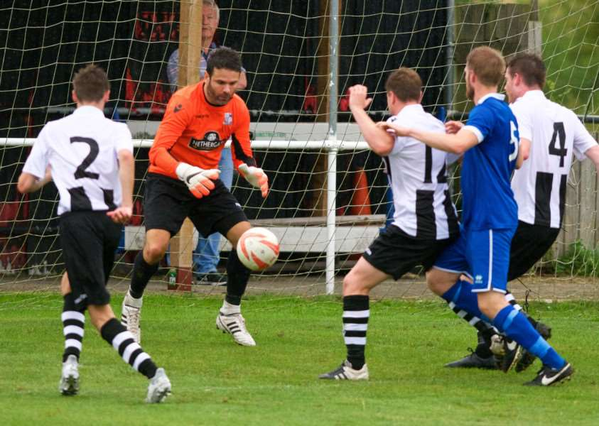 GOOD DRAW: Long Melford (black and white) will face Ipswich Town in the Suffolk Premier Cup