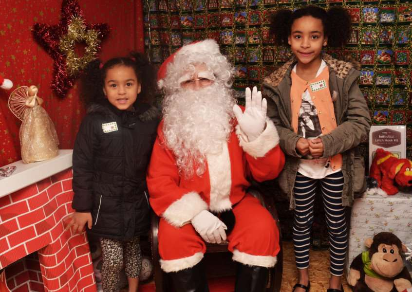 Santa welcomes siters Ayana (right) and Amaya to his grotto in Queen's Square, Haverhill. Picture: David Doughty. ANL-151222-134928001