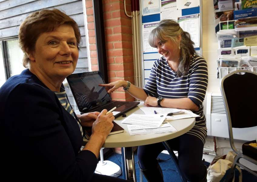 Cllr Mary Evans receives advice at the CAB's Energy Clinic at Clare Library