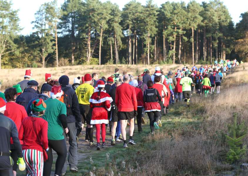 Runners enjoy the Festive Forest Challenge at West Stow Country Park