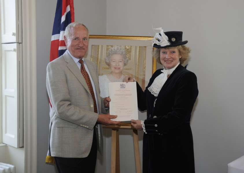 Judith hands Raimund Schlindwein, who has lived in the country for the past 50 years, his certificate of naturlisation at a British Citizens Ceremony